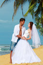 Young married couple dancing on a beach in a tropical destination Royalty Free Stock Photography