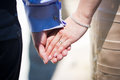 Young married couple holding hands on wedding day Royalty Free Stock Images