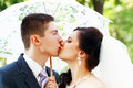 Young married couple kissing beautiful picture of a nice outdoor at the street Royalty Free Stock Image
