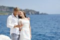 Young married couple toast by the sea after their wedding Royalty Free Stock Photo