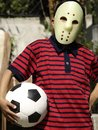 A young masked footballer Royalty Free Stock Images