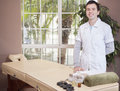 Young masseuse loving his job handsome greeting customers with a smile Stock Images