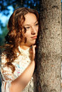 Young melancholy girl with curly hair Royalty Free Stock Photos