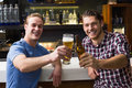 Young men drinking beer together Royalty Free Stock Photo