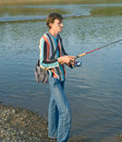Young men fishes Royalty Free Stock Photo