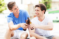 Young men having beer together Royalty Free Stock Photo