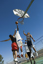 Young Men Playing Basketball On Court Royalty Free Stock Photo