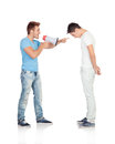Young men screams to his friend through a megaphone isolated on white background Royalty Free Stock Photography