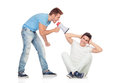 Young men screams to his friend through a megaphone isolated on white background Stock Images