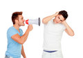 Young men screams to his friend through a megaphone isolated on white background Royalty Free Stock Photo