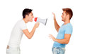 Young men screams to his friend through a megaphone isolated on white background Stock Photo