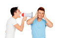 Young men screams to his friend through a megaphone isolated on white background Stock Photos