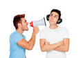 Young men screams to his friend through a megaphone isolated on white background Royalty Free Stock Images