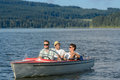 Young men sitting in motorboat in scenic landscape Royalty Free Stock Images