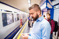 Young men in subway Royalty Free Stock Photo
