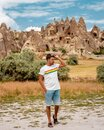 Young men on vacation Cappadocia Turkey sunrise in the hills with hot air balloons, Kapadokya Beautiful vibrant colorful Royalty Free Stock Photo