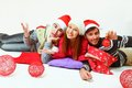 image photo : Young men and woman with a pillow, Santa Claus hats and balloons