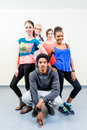 Young men and women in dance class posing Royalty Free Stock Photo