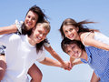 Young men and women piggy back and having fun Royalty Free Stock Photos