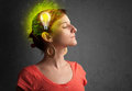 Young mind thinking of green eco energy with lightbulb on grungy background Royalty Free Stock Photography