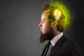 Young mind thinking of green eco energy with lightbulb on grungy background Royalty Free Stock Image