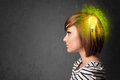 Young mind thinking of green eco energy with lightbulb on grungy background Stock Image