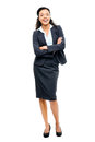 Young mixed race businesswoman with arms folded smiling isolated business woman Royalty Free Stock Image