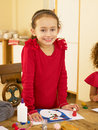 Young mixed race child making Christmas cards Royalty Free Stock Images