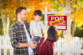 Young Mixed Race Chinese Caucasian Family In Front of Sold Sign Royalty Free Stock Photo