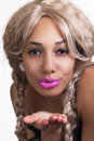 Young mixed woman blowing kiss blond wig black Stock Photography