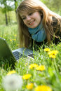 Young model with laptop on green grass Royalty Free Stock Photo