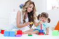 Young mom with her child play together Royalty Free Stock Photo