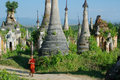 Young monk between stupas Royalty Free Stock Photography