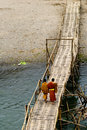 Young Monks on a bridge, Luang Prabang, Laos Stock Image