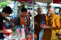 Young monks buddhist buying refreshments at a street stall in bangkok thailand Stock Photo
