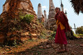 Young monks going to monastery myanmar inthein inle lake near stupas Stock Photo