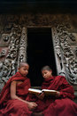 Young monks reading a book at shwenandaw monastery in mandalay m myanmar march novice studying pali buddhist or golden palace on Stock Images