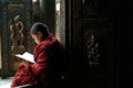 Young monks reading a book at shwenandaw monastery mandalay myanmar march novice studying pali buddhist or golden palace on march Stock Photo