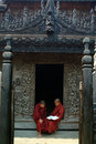 Young monks reading a book at shwenandaw monastery mandalay myanmar march novice studying pali buddhist or golden palace on march Royalty Free Stock Photos