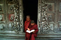 Young monks reading a book at shwenandaw monastery mandalay myanmar march novice studying pali buddhist or golden palace on march Royalty Free Stock Photo