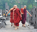Young monks walking on the wooden bridge in Shan, Myanmar Royalty Free Stock Photo