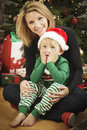 Young Mother and Baby Son Christmas Portrait Stock Images