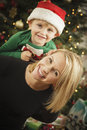 Young Mother and Baby Son Christmas Portrait Stock Photos