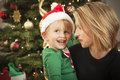 Young Mother and Baby Son Christmas Portrait Stock Photo