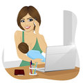 Young mother breastfeeds her baby while talking on the phone and working with laptop at home Royalty Free Stock Photography