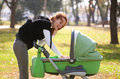 Young mother carrying baby in autumn park Stock Image