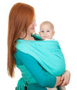 Young mother carrying baby boy sitting in sling Stock Photo