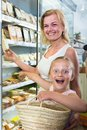 Mother with daughter buying chilled foods in supermarket Royalty Free Stock Photo