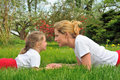 Young mother and daughter on the grass Stock Photo