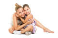 Young mother and daughter hugging and smiling caucasian sitting on the floor looking at camera isolated on white background Royalty Free Stock Photo